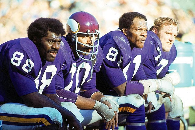 the purple people eaters on the bench